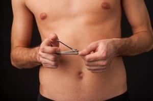man using nail clipper